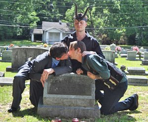 SAME SEX COUPLES MAKE OUT ON GRAVE2